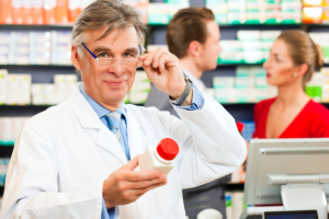 Pharmacist holding a medicine bottle